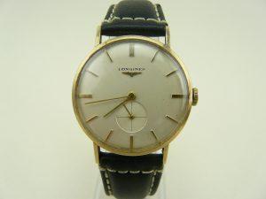 Longines gold watch